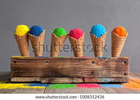 Bright colours in shapes of ice cream scoops in cones for Indian holi festival. Colorful gulal (powder colors) for Happy Holi. - Shutterstock ID 1008312436