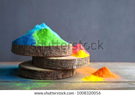 Bright colours on sawed wood for Indian holi festival. Colorful gulal (powder colors) for Happy Holi with copy space. #1008320056