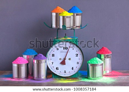Bright colours with weigher or scales for Indian holi festival. Colorful gulal (powder colors) for Happy Holi with copy space. #1008357184