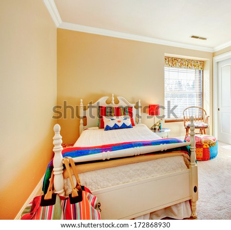 Bright cream tones young adult room with rustic wooden furniture