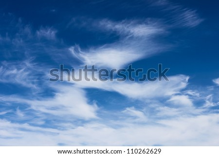 bright cumulus clouds and blue sky background