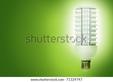 Bright, energy efficient light bulb consisting of 224 separate diodes, against green background.