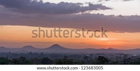 Bright evening glow over mountains. Arusha, Tanzania.