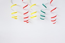 Bright festive decor. The multi-colored serpentine on a white background