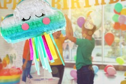 Bright festive pinata hanging indoors at birthday party, space for text