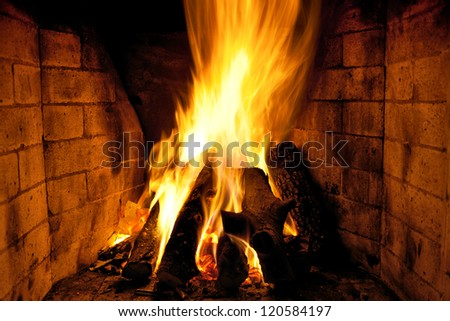 bright flame of fire in the fireplace