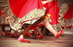 Bright fragment of fast Russian folk dance with red girls waved skirt