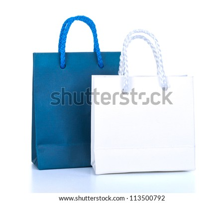 Bright gift bags isolated on white background