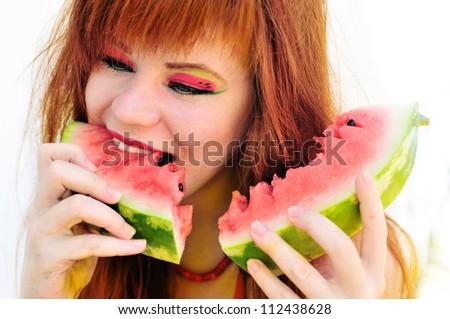 bright ginger girl enjoying of watermelon