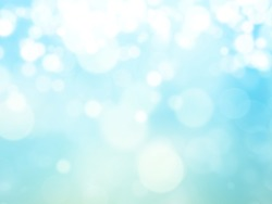 Bright glowing blue abstract background in the form of bokeh