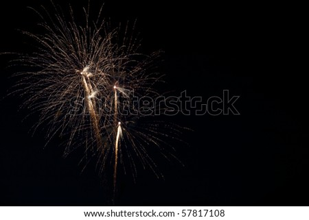 Bright gold colored fireworks at left of frame