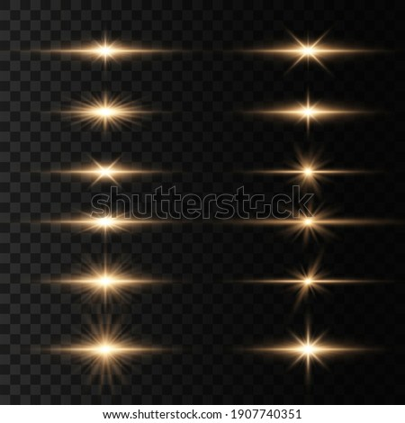 Bright gold flashes and glares. Set of flashes, Lights and Sparkles on a transparent background. Abstract golden lights isolated  Bright rays of light. Glowing lines.