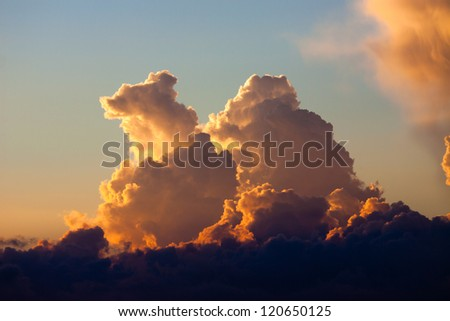 Bright golden clouds on the sunset sky