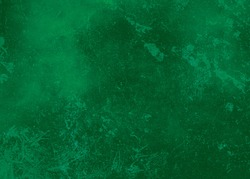 Bright green abstract textured background texture to the point with bright spots of paint. Blank background design banner.