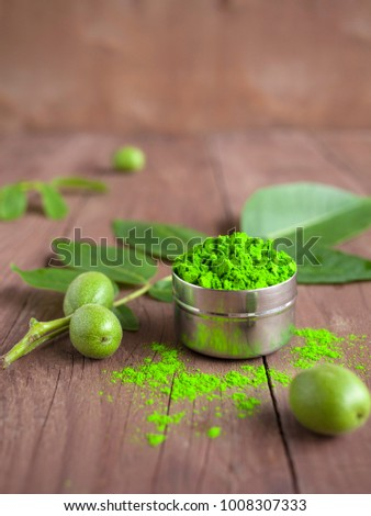 Bright green colour for Indian holi festival. Colorful gulal (powder color) for Happy Holi with copy space. #1008307333