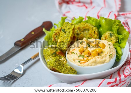 Bright green falafel with hummus. Love for a healthy vegan food concept #608370200
