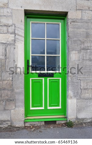 Bright Green Front Door of a Cottage