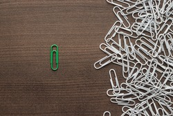 bright green paper clip unique idea concept