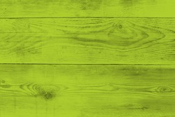 Bright green wood structure as a background texture.