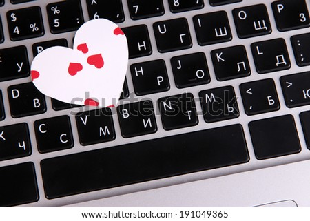 Bright heart on computer keyboard close up
