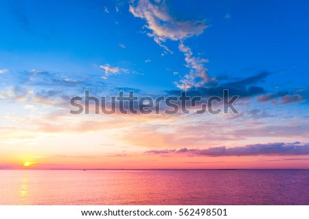 Bright Horizon Sunset over Water  #562498501