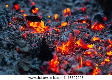 bright hot coal glows orange lights #1418327225