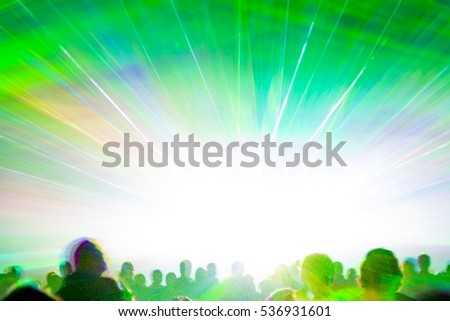 Bright laser show rays stream. Very colorful show with a crowd silhouette and great laser rays on pyrotechnic festival in germany #536931601