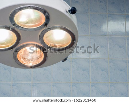 Bright light from the operating lamp. Modern medical equipment. Close-up. Stock photo ©