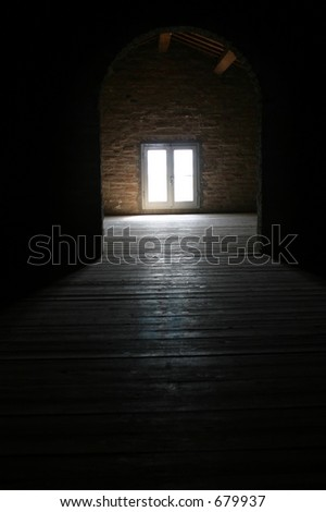 Bright light shining through the window of an attic, a beautiful reflection on the wooden floor.