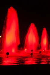 Bright lighted fountains. Beauty on the streets of a night European city