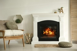 Bright living room interior with fireplace and basket of firewood