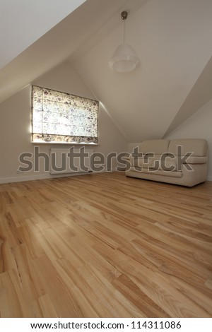 Bright living room on the attic of modern house