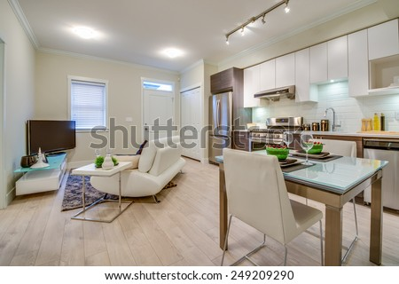 Bright living room with kitchen and dinner table. Interior design. #249209290