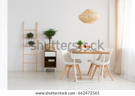 Bright minimal dining room in slow life trend