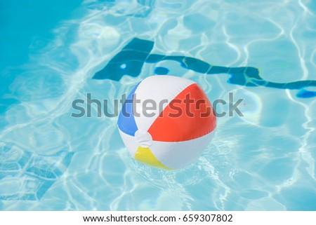 swimming pool beach ball background. Bright Multicolor Beach Ball Floating In Blue Swimming Pool, Colorful Float A Refreshing Pool Background E