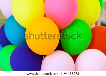 Bright multicolored balloons close-up, festive abstract background for different themes #1194138973