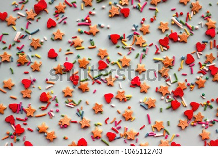 Bright multicolored figures, colored dragees on a light background. A merry holiday, a party, a sweet treat. Top view, daylight. #1065112703