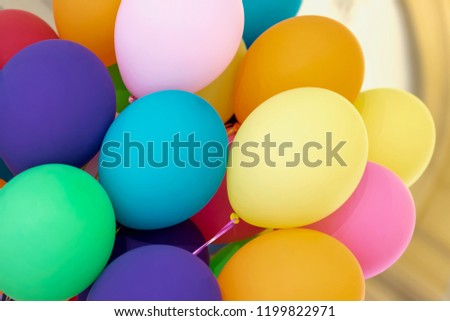 Bright multicolored helium balloons close-up, festive colorful abstract background for different themes #1199822971