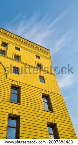 Bright neoclassicism house in the rays of the sun.