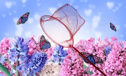 Bright net and fragile monarch butterflies in flower garden