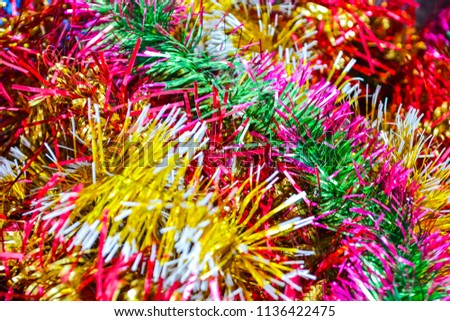 Bright New Year's Christmas background from multi-colored tinsel. #1136422475