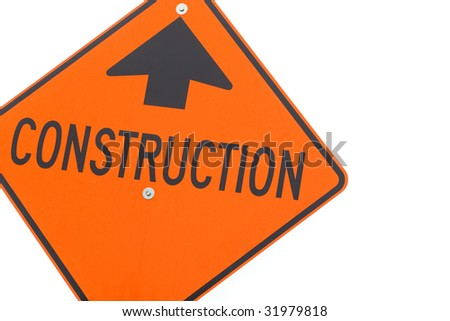 Bright orange construction sign, isolated on white.
