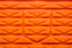 Bright Orange Rubber Textured Shoe Tread Surface