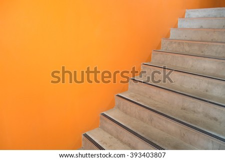 Bright orange wall and staircase to next floor