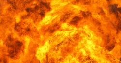 Bright out of the raging flames of  huge fire