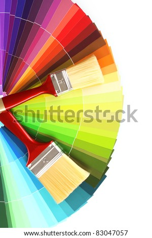bright palette of colors and paint brushes isolated on white