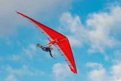 Bright paraglider wing in the sky. Extreme sports