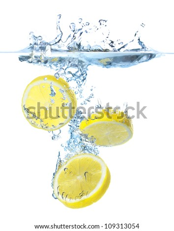 Bright parts of lemon under water. Tasty and healthy food