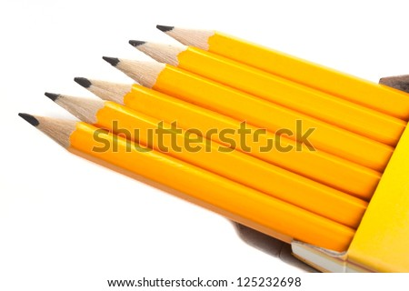 Bright pencils in a box isolated on white background