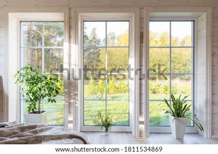 Bright photo studio interior with big window, high ceiling, white wooden floor Foto stock ©